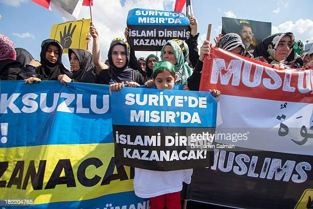Following the Friday prayer, many Turkish citizens gathered at the yard of Fatih Mosque in Istanbul and chanted slogans against Syria's Bashar...