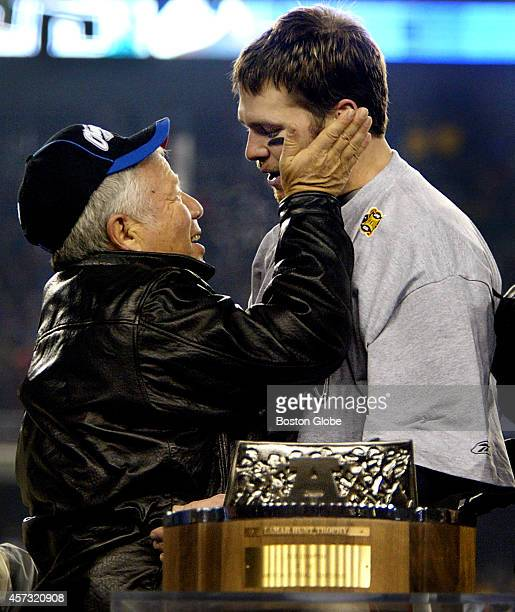 Following the New England Patriots 2414 victory over the Indianapolis Colts Team Owner Robert Kraft left congratulates quarterback Tom Brady right as...