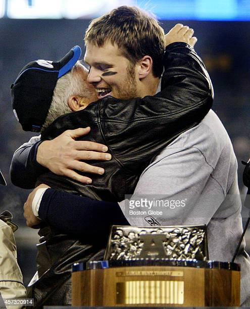 Following the New England Patriots 2414 victory over the Indianapolis Colts Team Owner Robert Kraft left hugs quarterback Tom Brady right as they...