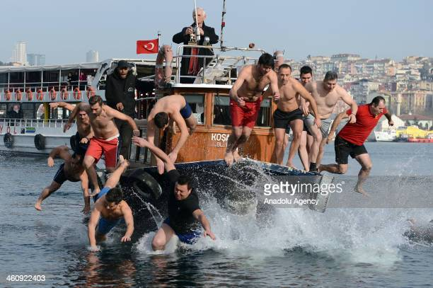 Following the rite at Greek Patriarchate of the Fener in Istanbul within the Epiphany volunteers tried to recover the cross casted into the water...