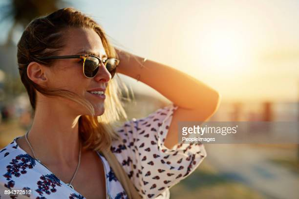 following the sun - sunglasses stock pictures, royalty-free photos & images