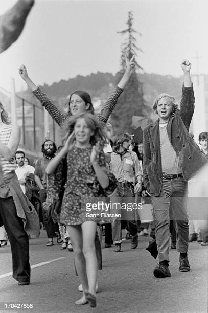 Following their graduation ceremony members of the University of California at Berkeley's class of 1969 and unidentified others march they way...