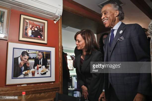 Following their lunch meeting civil rights leader Rev Al Sharpton shows Democratic presidential candidate Sen Kamala Harris a photo of a previous...