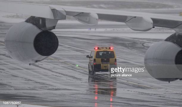 A FollowMe car on the runway in heavy snow at Frankfurt Airport Germany 10 January 2017 Meteorologists have forecast further snowfall and sinking...