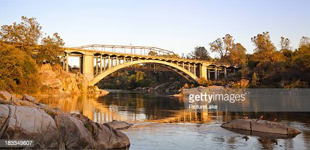 folsom rainbow bridge panorama at sunset - sacramento stock pictures, royalty-free photos & images