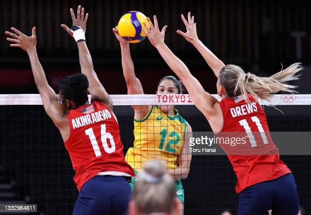Foluke Akinradewo and Andrea Drews of Team United States compete against Natalia Pereira of Team Brazil during the Women's Gold Medal Match on day...