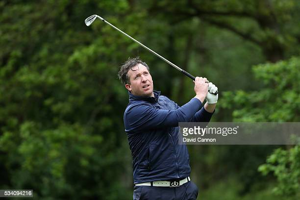 Fomer footballer Robbie Fowler tees off during the ProAm prior to the BMW PGA Championship at Wentworth on May 25 2016 in Virginia Water England