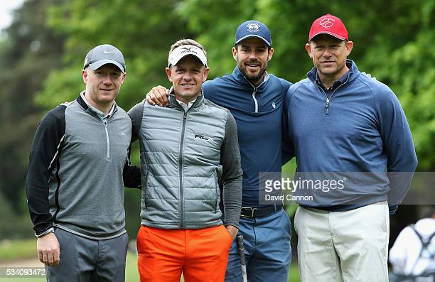 Fomer footballers Paul Scholes Peter Schmeichel and Jamie Redknapp pose with Luke Donald of England during the ProAm prior to the BMW PGA...