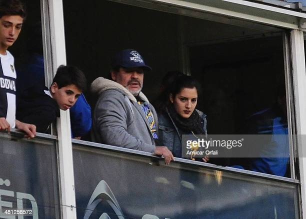 Fomer soccer player Diego Maradona and his daughter Jana Maradona during a match between Boca Juniors and Quilmes as part of 17th round of Torneo...
