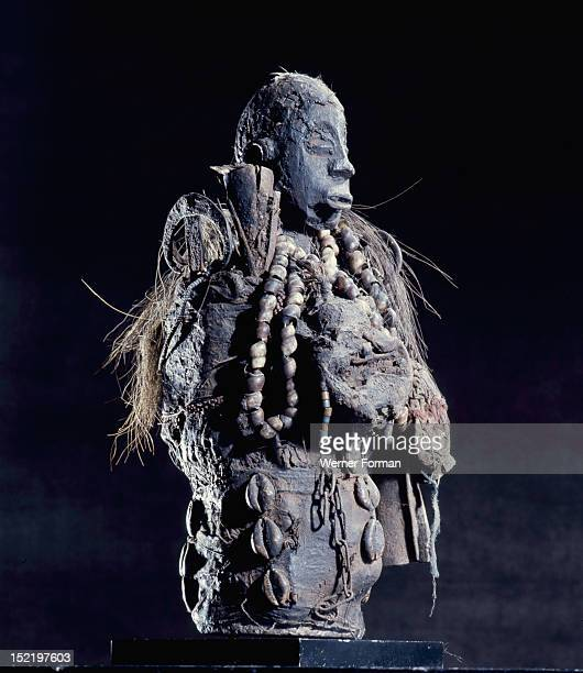 A Fon bocio figure deriving its magic power from the potent accumulation of charged ingredients Fon religion was directed towards spirits called vodu...