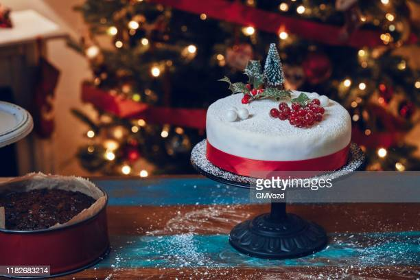 fondant christmas cake with dried fruits and nuts - christmas cake stock photos and pictures