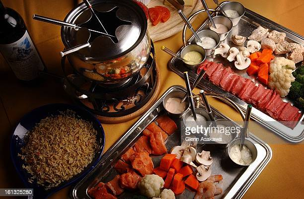 FONDUE121701Various meats seafoods poultry and vegetables can be used for a fondue as illustrated by the chef at the Swiss Haven Restaurant 5946 S...