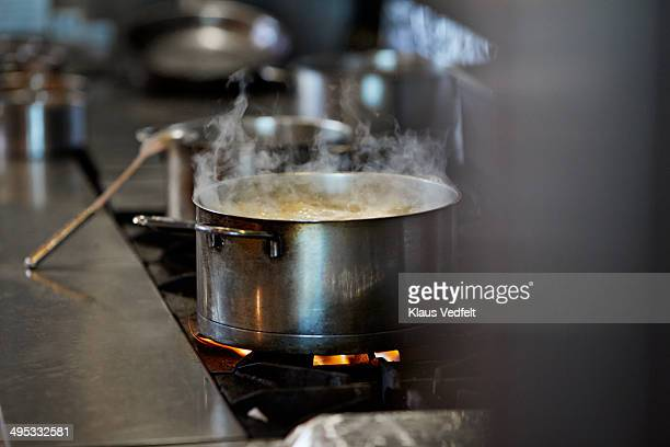 font cooking on stow in kitchen at restaurant - cooking pan stock pictures, royalty-free photos & images