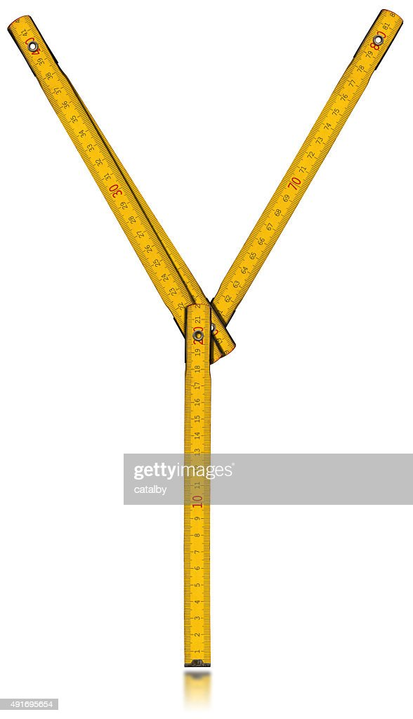 Font Y Old Yellow Meter Ruler Stock Photo - Getty Images