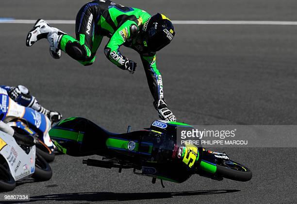 Fontana Racing team's Italian Ricardo Moretti falls during the 125cc race of the Spanish Grand Prix at the Jerez racetrack on May 2 2010 in Jerez de...