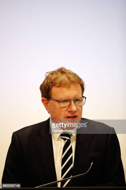 Fonterra's Chairman John Wilson speaks to the media on December 1 2017 in Auckland New Zealand Fonterra has been ordered to pay Danone 105 million...