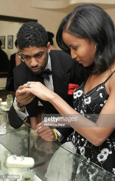 Fonzworth Bentley and Faune Chambers look at Erica Courtney jewelry