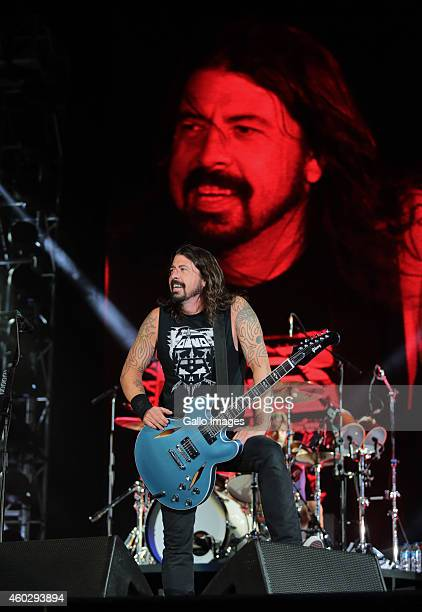 Foo Fighters frontman Dave Grohl performs during their concert on December 10 2014 at the Cape Town Stadium in Cape Town South Africa Last night was...