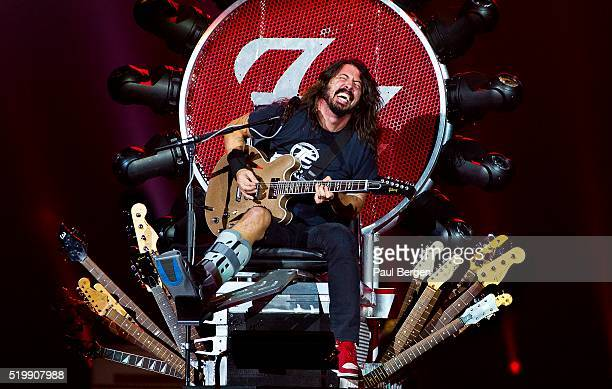 Foo Fighters singer and guitarist Dave Grohl performs on stage in a special throne, due to his broken leg, at Ziggodome, Amsterdam, Netherlands, 05...