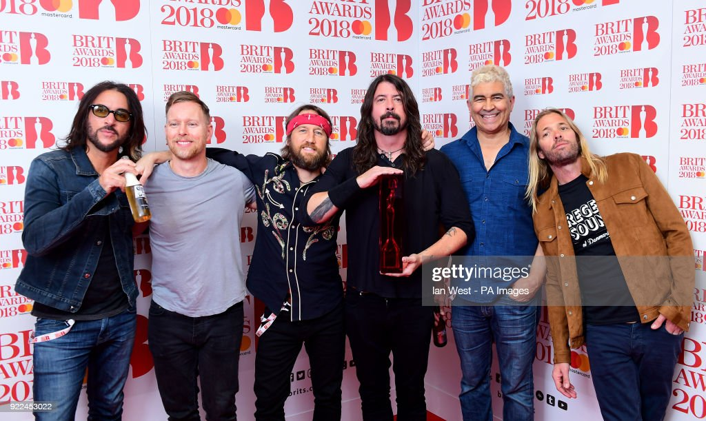 Foo Fighters with their award for Best International Group in the press room during the Brit Awards at the O2 Arena, London