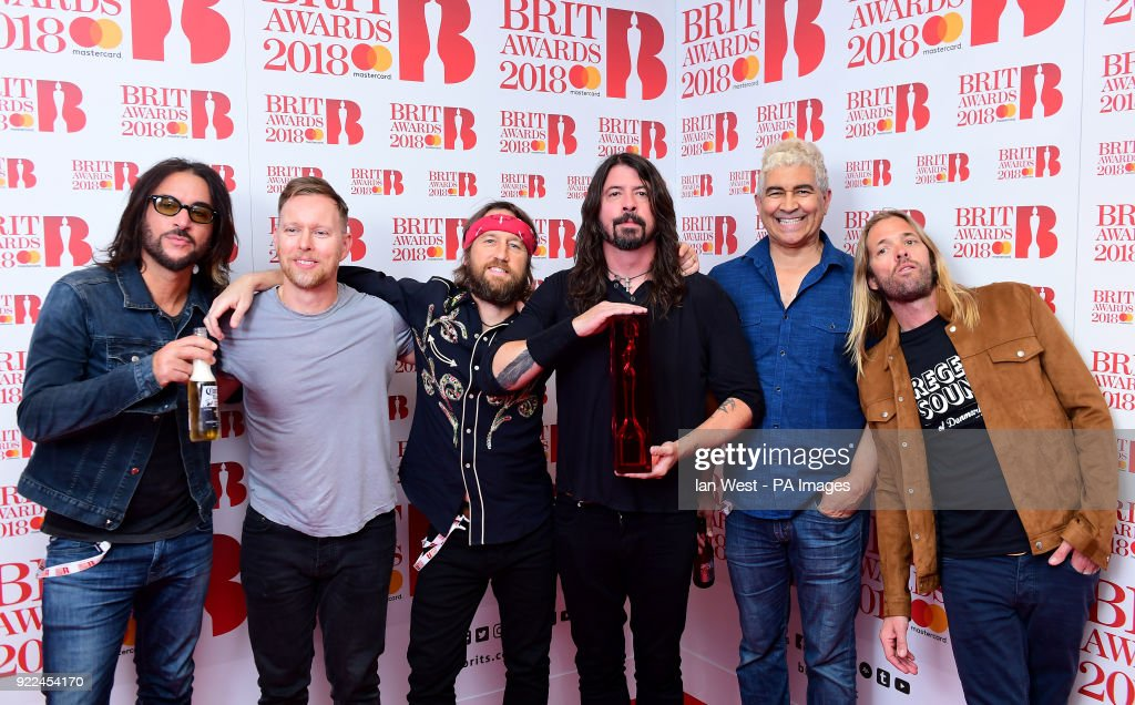 Foo Fighters with their award for Best International Group in the press room during the Brit Awards at the O2 Arena, London.