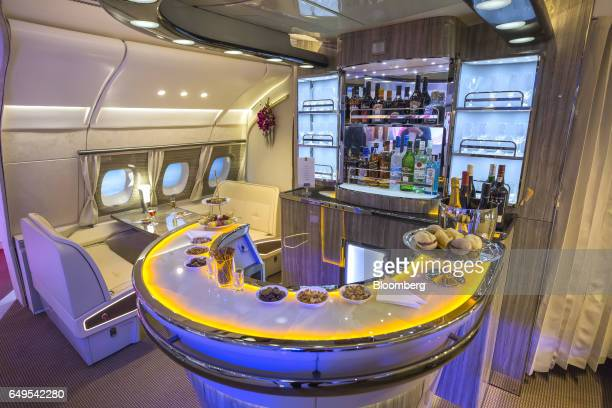 Food and a selection of beverages are laid out on the new bar area for the Airbus A380 aircraft during the unveiling at the ITB Travel Fair in Berlin...