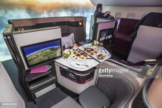 Food and beverages are seen laid out on the new seating for Qatar Airways Ltd during the unveiling at the ITB Travel Fair in Berlin Germany on...