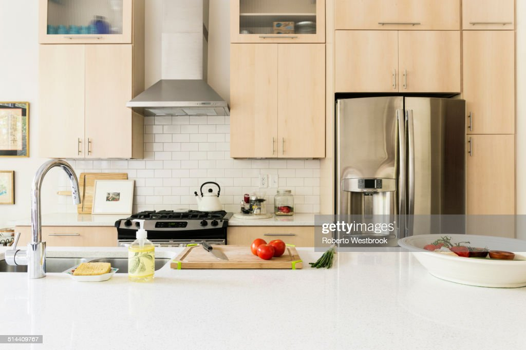Food and cooking implements on kitchen counter : Stock Photo