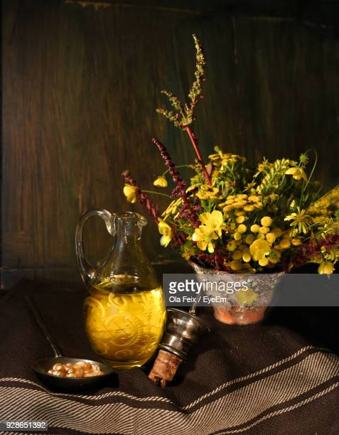 Food And Cooking Oil By Potted Plant On Tablecloth