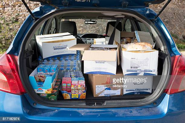 Food and drink for refugees stacked in a car trunk