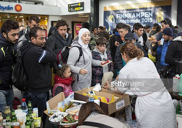 Food and drink is distributed by volunteers to refugees that arrived at Malmoe train station in Malmoe Sweden in the morning of September 10 2015 AFP...