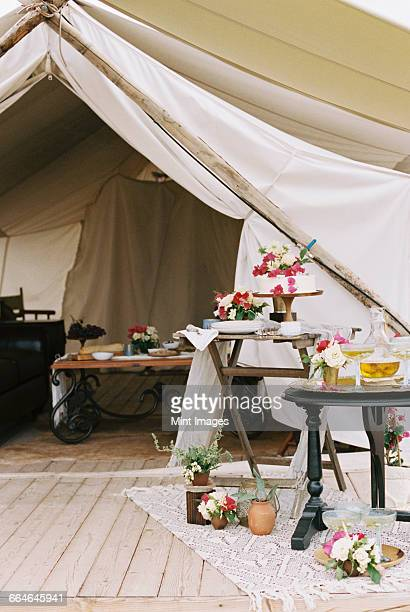 Food and drink on tables outside a tent