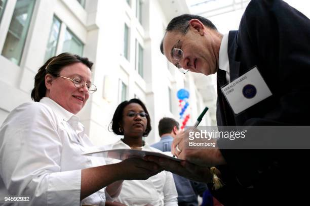 Food and Drug Administration Research Engineer Gerald R Harris PhD with the Office Of Science and Engineering Laboratories signs autographs for...