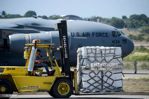 Food and medicine aid for Venezuela is unloaded from a US Air Force C17 aircraft at Camilo Daza International Airport in Cucuta Colombia in the...