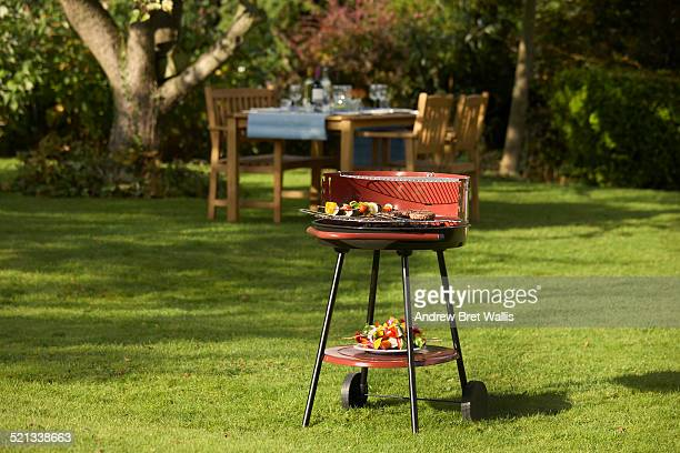 BBQ food and table set for garden dining