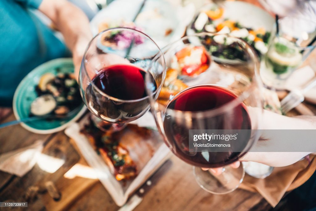 Food and wine brings people together : Stock Photo