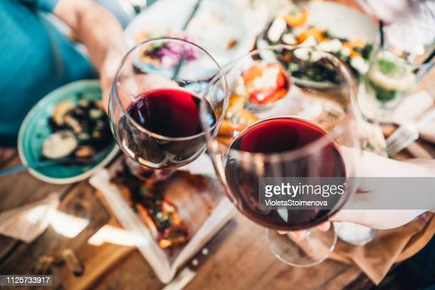 food and wine brings people together - refreshment stock pictures, royalty-free photos & images