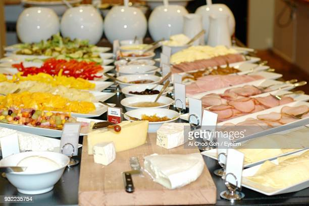 Food Arranged In Plates On Table For Sale