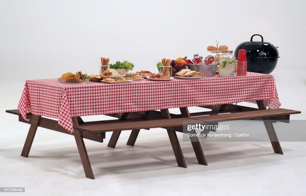 Food Arranged On Picnic Table Against White Background : Stock Photo