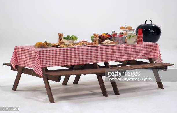 food arranged on picnic table against white background - grill concept stock photos and pictures