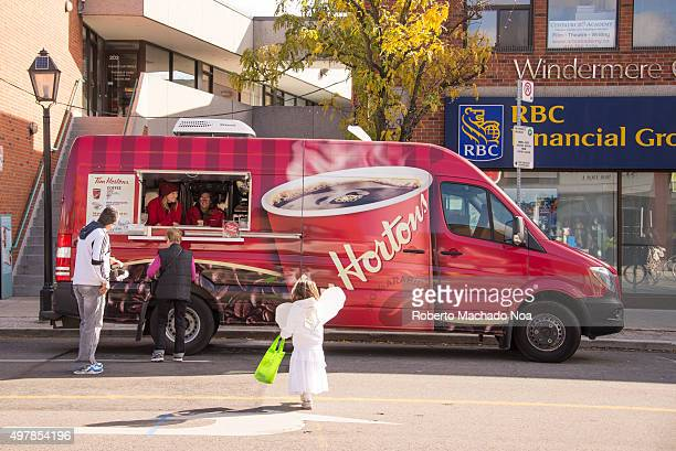 Food at TO West Halloween Fest 2015 Tim Hortons selling coffee and doughnuts in a van at the fest Toronto West Halloween Fest at BloorWest Village is...