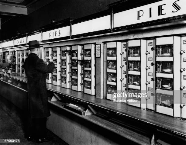 A food automat selling pies and cakes New York City USA 1936