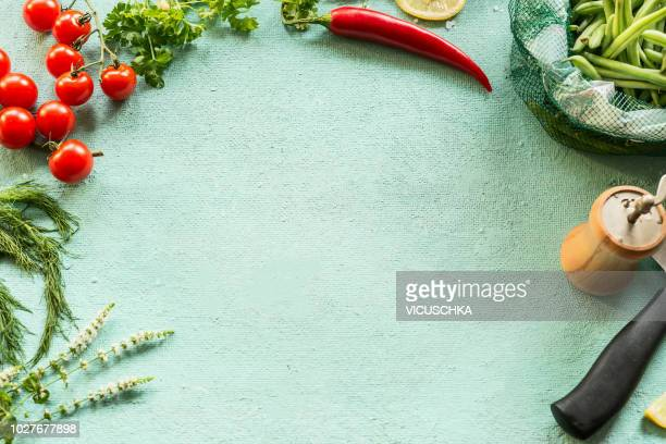 food background frame with seasoning, chili pepper, green beans and knife - cooking utensil stock photos and pictures