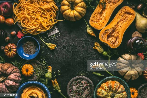 food background frame with various pumpkins on dark kitchen table, top view - kitchen background stock pictures, royalty-free photos & images
