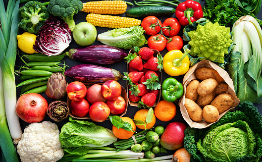 Food background with assortment of fresh organic fruits and vegetables 1203599963