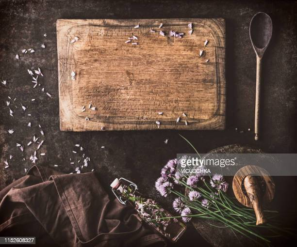 food background with chive blossom vinegar - cutting board stock pictures, royalty-free photos & images