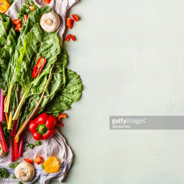 food background with colorful chard leaves and ingredients - arrangement stock pictures, royalty-free photos & images
