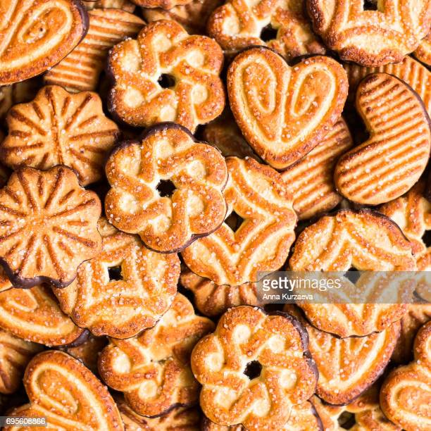 Food background with sugar cookies, top view