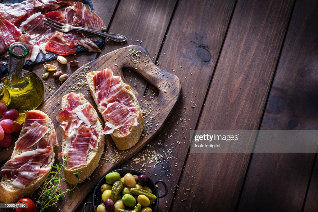 Food backgrounds: Preparing iberico ham sandwich/spanish bocadillo de jamon iberico : Stock Photo