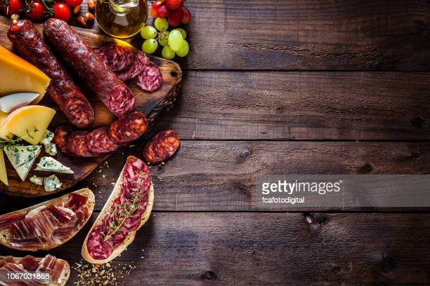 food backgrounds: spanish chorizo and cheeses - chorizo stock pictures, royalty-free photos & images